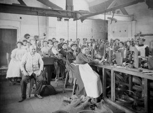 Nearly all ladies and girls again but this time in the assembly shop with a very weary looking foreman in the foreground.