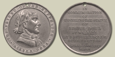 The front and back of the medal struck to commemorate the unveiling.