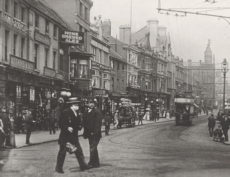 The grocers of Attkins & Son is on left side of this photograph taken around 1906.