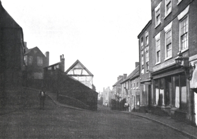 A view taken from the junction of Church Street and Peal Street c.1930. On the right is the Three Swans and Peal, later known as The House That Jack Built. In the middle of the picture is the White Swan pub on Dudley and Bath Streets. On the left is New Street with all its twist and turns. (Taken from Walsall Chronicle No.2 1980)