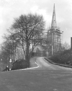 The view up Church Street from Dudley Street at its junction with New Street on the right. This picture dates from 1949 as it was at this time the spire of St. Matthews was being renovated.