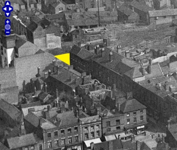 The yellow triangle shows the approximate site of the demolished Bull's Head and Greyhound pubs in this image from Britain From Above.