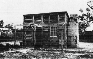 The first school building, the new school can be seen in the background on the left of the picture. (Busselton History Society)