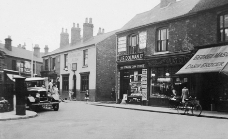 The premises of J .E. Dolman Ltd,. with the Bakers Inn next to the gulley that ran round to Careless Street.