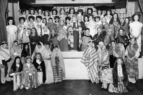Back row:- ?, ?, ?, ?, ?, Janet Greystone, ?, Zania Bottomer, Robina Willetts, Elizabeth Mold, ? Second row down:- Susan Levitt, Carol Morgan, Hilary Thompson, ?, ?, Sandra Day (I think), Diane Griffiths, ?, girl who played Mary is unknown, Philip Sturrock (I think) who played Joseph, Peter Martin (I think), ?, ?, ?, Graham Barrows, Philip Morris (I think), David Letts, Diane Reynolds (I think). Third row down:- ?, John Griffiths, Stuart Ormonde, John Pitcock, Raymond Hyden, ?, ?, ?, Brian Burgess. Left hand group standing:- ?, ?, ?, ?, ?, Susan Horlick (I think). Kneeling;- Graham Worrall, David Harper, ? Right hand group standing:- ?, ?, Michael Garbett (I think), ?, ?, John Russell. Kneeling:- Peter Morris, Francis Gale.