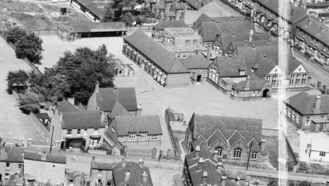 A view of the Senior school in 1950. The church building in the right foreground is not part of the school.