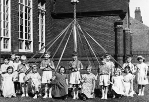 The children from North Walsall Infants School posing around the maypole in 1954.
